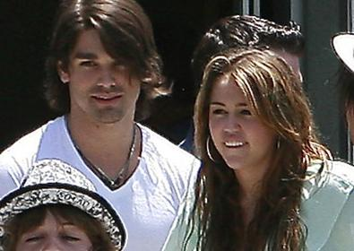 Justin Gaston and Miley Cyrus