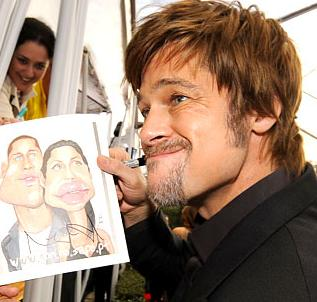 Brad Pitt is holding Brangelina picture